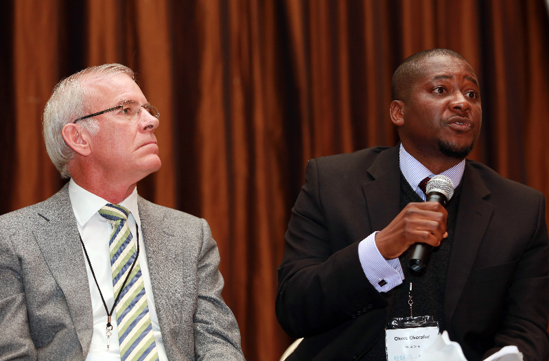 KLEINMOND, SOUTH AFRICA - JUNE 22:  Brian Brink, Vice President of Anglo American, and Okore Okorafor, Senior Health specialist, World Bank,at the Conference on Global Health and Faith Based Communities on June 22, 2015 in Kleinmond, South Africa. The Conference on Global Health and Faith Based Communities is hosted by the Ecumenical Foundation of Southern Africa (EFSA) in partnership with the Ahimsa Roundtable (France) and World Faiths Development Dialogue (Washington-DC). [Other sponsors include The Global Fund, World Vision, UnitAid, Gavi, Brot für die Welt, Sanofi Pasteur, The Handa Foundation, Fondation Raja, Ahimsa Partners and Thelem.] The Conference, with more than 100 delegates from approximately 30 countries, runs from 21-24 June 2015 at the Arabella Hotel & Spa, Kleinmond, Western-Cape, South Africa. (Photo by Gallo Images / Nardus Engelbrecht)