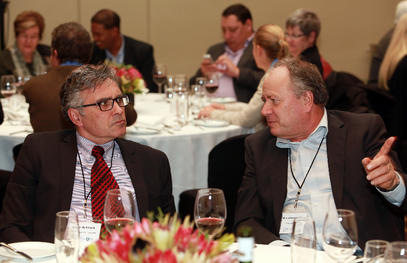 KLEINMOND, SOUTH AFRICA - JUNE 22: Rector and Vice Chancellor of Stellenbosch University, Professor Wim de Villiers and Dr. Renier Koeglenberg, Executive Director of Ecumenical Foundation of Southern Africa, at the Conference on Global Health and Faith Based Communities on June 22, 2015 in Kleinmond, South Africa. The Conference on Global Health and Faith Based Communities is hosted by the Ecumenical Foundation of Southern Africa (EFSA) in partnership with the Ahimsa Roundtable (France) and World Faiths Development Dialogue (Washington-DC). [Other sponsors include The Global Fund, World Vision, UnitAid, Gavi, Brot für die Welt, Sanofi Pasteur, The Handa Foundation, Fondation Raja, Ahimsa Partners and Thelem.] The Conference, with more than 100 delegates from approximately 30 countries, runs from 21-24 June 2015 at the Arabella Hotel & Spa, Kleinmond, Western-Cape, South Africa. (Photo by Gallo Images / Nardus Engelbrecht)