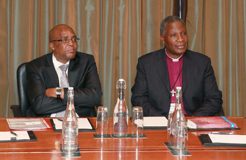 KLEINMOND, SOUTH AFRICA - JUNE 21: Minister of Health, Aaron Motsoaledi and Anglican Archbishop Thabo Makgoba at the Conference on Global Health and Faith Based Communities on June 21, 2015 in Kleinmond, South Africa. The Conference on Global Health and Faith Based Communities is hosted by the Ecumenical Foundation of Southern Africa (EFSA) in partnership with the Ahimsa Roundtable (France) and World Faiths Development Dialogue (Washington-DC). [Other sponsors include The Global Fund, World Vision, UnitAid, Gavi, Brot für die Welt, Sanofi Pasteur, The Handa Foundation, Fondation Raja, Ahimsa Partners and Thelem.] The Conference, with more than 100 delegates from approximately 30 countries, runs from 21-24 June 2015 at the Arabella Hotel & Spa, Kleinmond, Western-Cape, South Africa. (Photo Nardus Engelbrecht)
